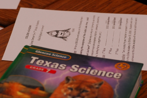 Essay contest form and science textbook. Photograph by Chris Buntenbah.