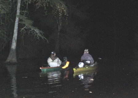TBRC Investigators Jerry Hestand and Mark Porter kayaking through Mercer Bayou in Arkansas.