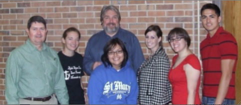 From left to right: Alton Higgins, Sarah Hundley, Thomas Woodruff, Katie O'Donnell, Kimberly Vela, and Manny Vasquez. In front wearing the St. Mary's sweatshirt is Maria Jimenez. Photo: Craig Woolheater.